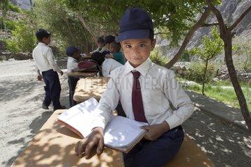 Schoolboy doing outdoor classroom - Himalaya India
