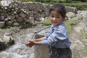 Schoolgirl washing hands - Nubra Valley India Himalayas