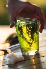 Rosmary tea on a garden terrace