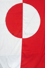 Denmark. Greenland. West coast. The Greenland flag is showing the sun refelecting on ice. As part of the danish kingdom  it has the same colors than the danish flag.