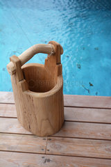 Wooden pot beside a swimming-pool with thermal water - Iceland