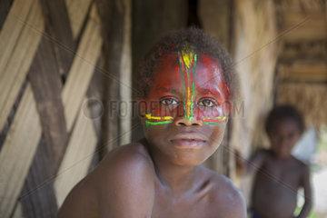 Portrait of boy in makeup color of the flag of Vanuatu