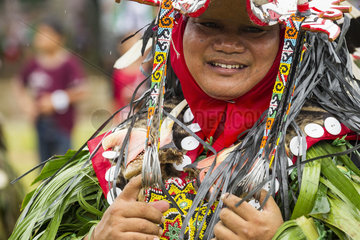 Man wearing mask and feather hornbill - Parade Hudoq