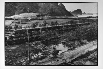 Coal train going towards the port of Hongai Vietnam