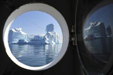 Denmark. Greenland. West coast. Iceberg seen through a boat window