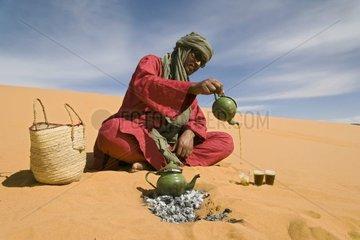 Tuareg preparing tea in the desert Gandoura Algeria