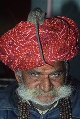 Portrait of an indian priest with a rat on the head India