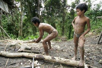 Man and boy cutting wood Tau't Batu Palawan Philippines