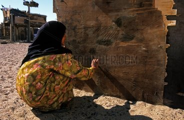 Bedouin girl drawing on the wall of his house Sinai