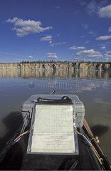 Kayak and The ramparts cliff on Mackenzie river Canada