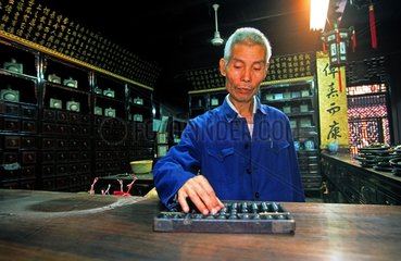 Pharmacist counting with an abacus Huanzhu China