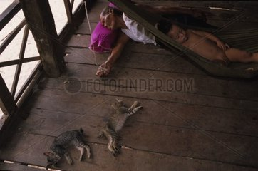 Family of Kampuchean sleeping with Kampuchea cats