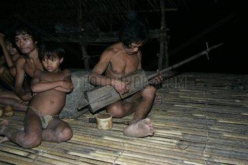 Man playing music in family Tau't Batu Palawan Philippines