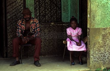 Father and daughter dressed for sunday mass in Jamaica
