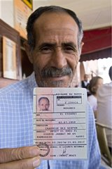 Snake charmer showing his identity card Marrakech