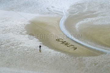 Ganja written on the sand of a beach of Normandy