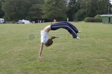Young girl practising gymnastics in the Forest of Dean