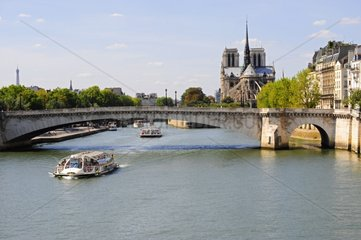 Notre-Dame and river boat on the Seine river in Paris