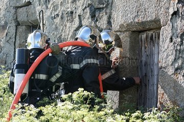Firefighters in office before an old house France