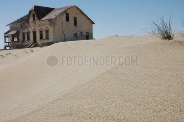 Deserted Komanskop city covered in sand Namibia
