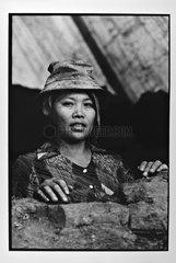 Woman coal miner at the port in Hanoi Vietnam
