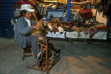 Spining alpaca wool Colca Valley Altiplano Peru