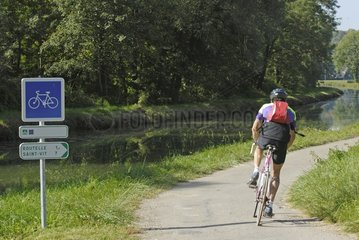 Cyclist on the Véloroute along the Rhone-Rhine Canal France