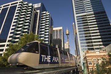 Tram passing between skyscrapers Darling Harbour Sydney