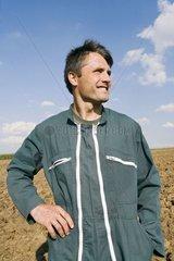Portrait of farmer in a ploughing field France