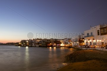 Houses in the Little Venice and restaurant on the beach Chora