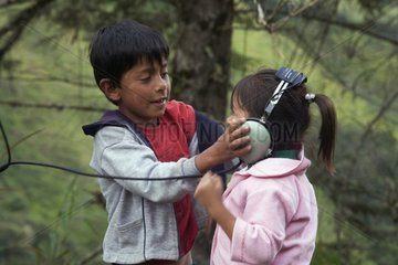 Children listening to the signal emitted by a collar