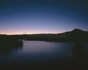 Raising of Moon on lake La Toba Castille Spain