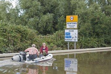 Couple returning shopping in a motor canoe UK