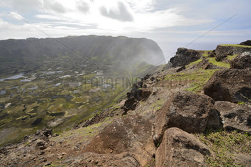Crater of the extinct volcano Rano Kau seen from the stone village of Orongo  Easter Island  Chile