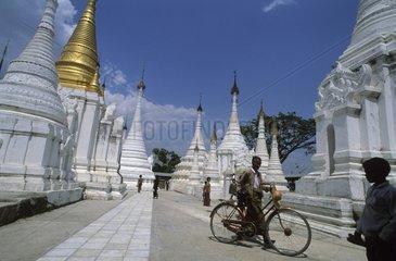 People in a street of Buddhist temple Burma