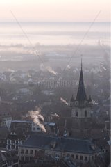 Town of Obernai in the early mist morning Alsace France
