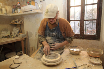 Potter working a piece of clay on a tower  Martine Gilles and Jaap Wieman  Village of Brantes  Provence  France