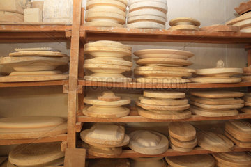 Molds for pieces of pottery on a shelf  Martine Gilles and Jaap Wieman  Brantes village  Provence  France