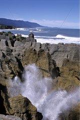 Blowholes in Pancake rock on Punakaiki coast New-Zeland