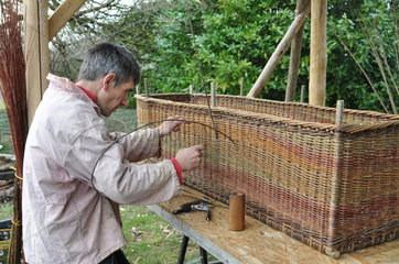 Making off a Wicker coffin for organic funeral