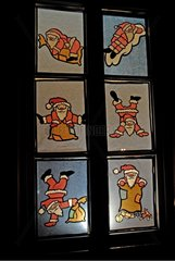 Windows of the Advent illuminated for Christmas in Alsace