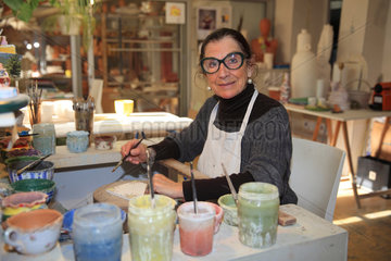 Craftswoman decorating ornamental tiles  Martine Gilles and Jaap Wieman  Brantes village  Provence  France