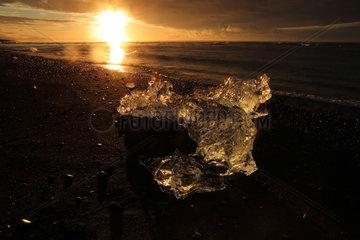 Sunrise and Ice on black sand beach  Jokulsarlon  Iceland