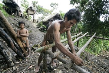 Man and boy building a house Tau't Batu Palawan