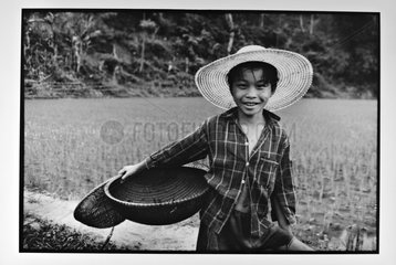 Portrait of a child in a ricefield Vietnam