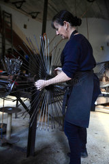 Frederique Fert installing the machine used to make a scourtin  Nyons  Provence  France