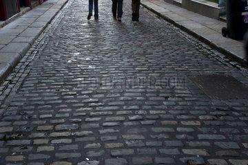 Pedestrians on the pavings of Dublin ireland