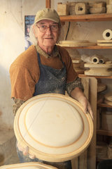 Potter presenting a mold in his workshop  Martine Gilles and Jaap Wieman  Village of Brantes  Provence  France