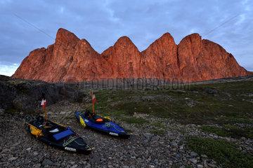 Kayaks Nautiraid in front of Dragon's Teeth  Bear's Archipelago  East Coast Greenland
