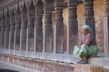 Old Nepalese sitting in Bhaktapur